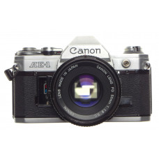CANON AE-1 chrome 35mm SLR film Classic camera with FD 50 1:1.8 lens with filter