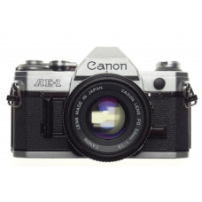 CANON AE-1 chrome 35mm SLR film camera with FD 50 1:1.8 lens