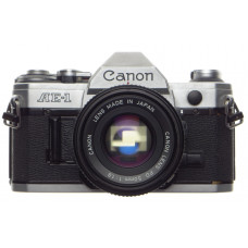CANON AE-1 chrome 35mm SLR film Classic camera with FD 50 1:1.8 lens with strap and cap