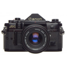 CANON A-1 black 35mm SLR film camera with FD 50 1:1.8 lens filter, strap and cap